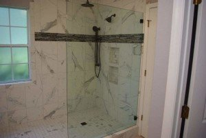 Marble shower with frameless glass